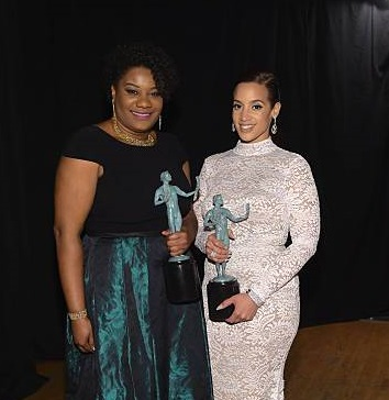 Adrienne C. Moore holding award
