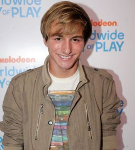 Lucas Cruikshank posing at an event