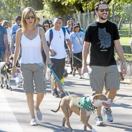 Wil and his wife taking their dog for a walk