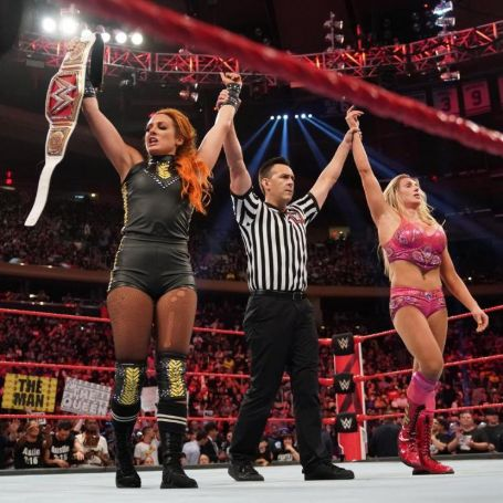 Becky Lynch holding Women Chamiponship title