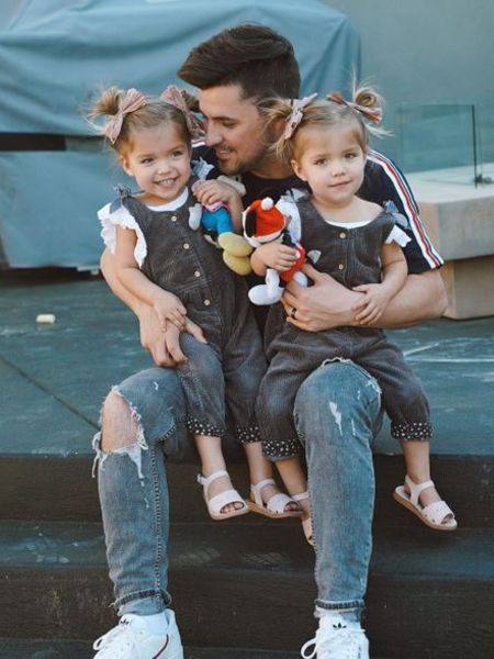 Kyler with his daughters