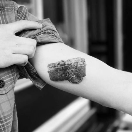 Doctor Woo tattooed this retro camera on Brooklyn's arm