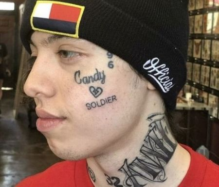 Lil Xan's face and neck tattoos