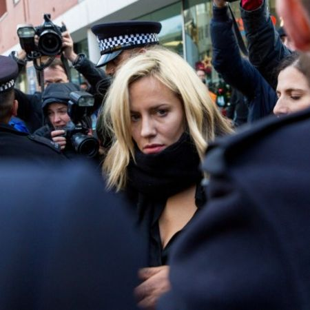 Caroline Flack being harassed by the media as she is escorted by police