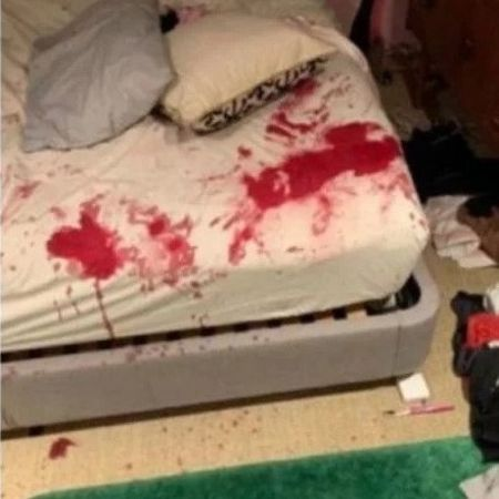 The bloody bed sheet covered mostly with Flack's blood