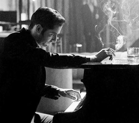 Tom Ellis playing the piano