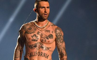 A Look At The More-Than-Two-Dozens Tattoos Of Maroon 5 Frontman Adam Levine